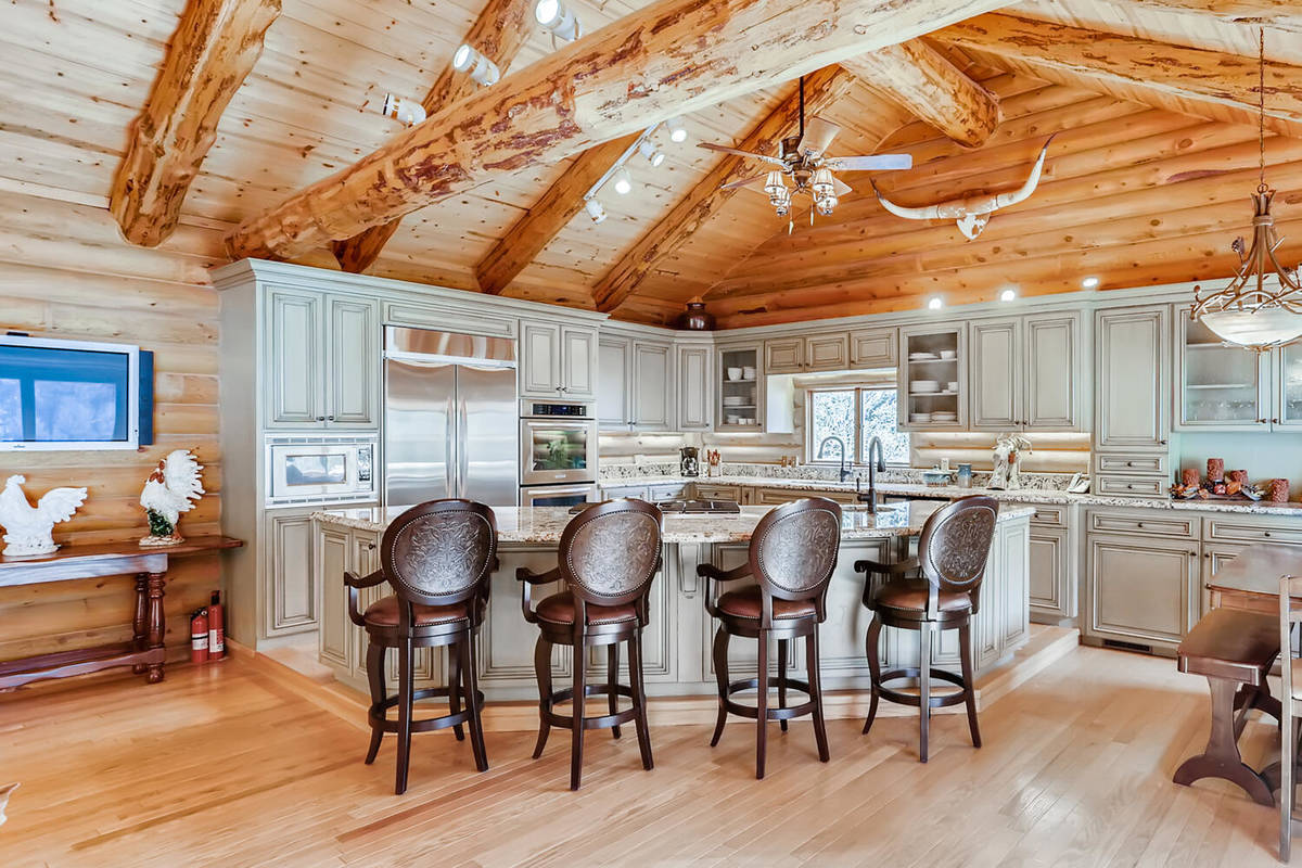 Mt. Charleston Realty The country-style kitchen is accentuated by a tongue-and-groove, cedar wo ...