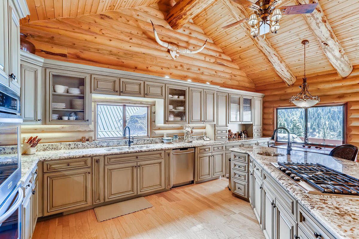 Mt. Charleston Realty Professional-grade stainless appliances — including a large built-in re ...