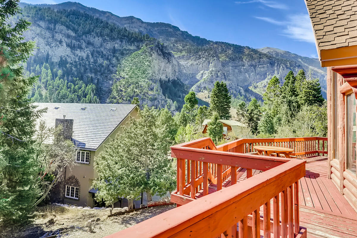Mt. Charleston Realty The cabin's decks overlook the forested backdrop of Toiyabe National Fore ...