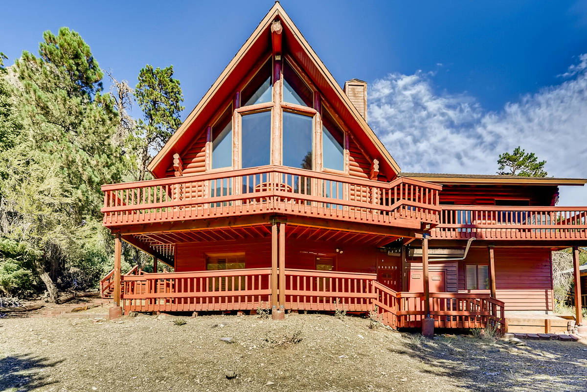 Mt. Charleston Realty The 3,728-square-foot cabin has the forested backdrop of the Toiyabe Nat ...