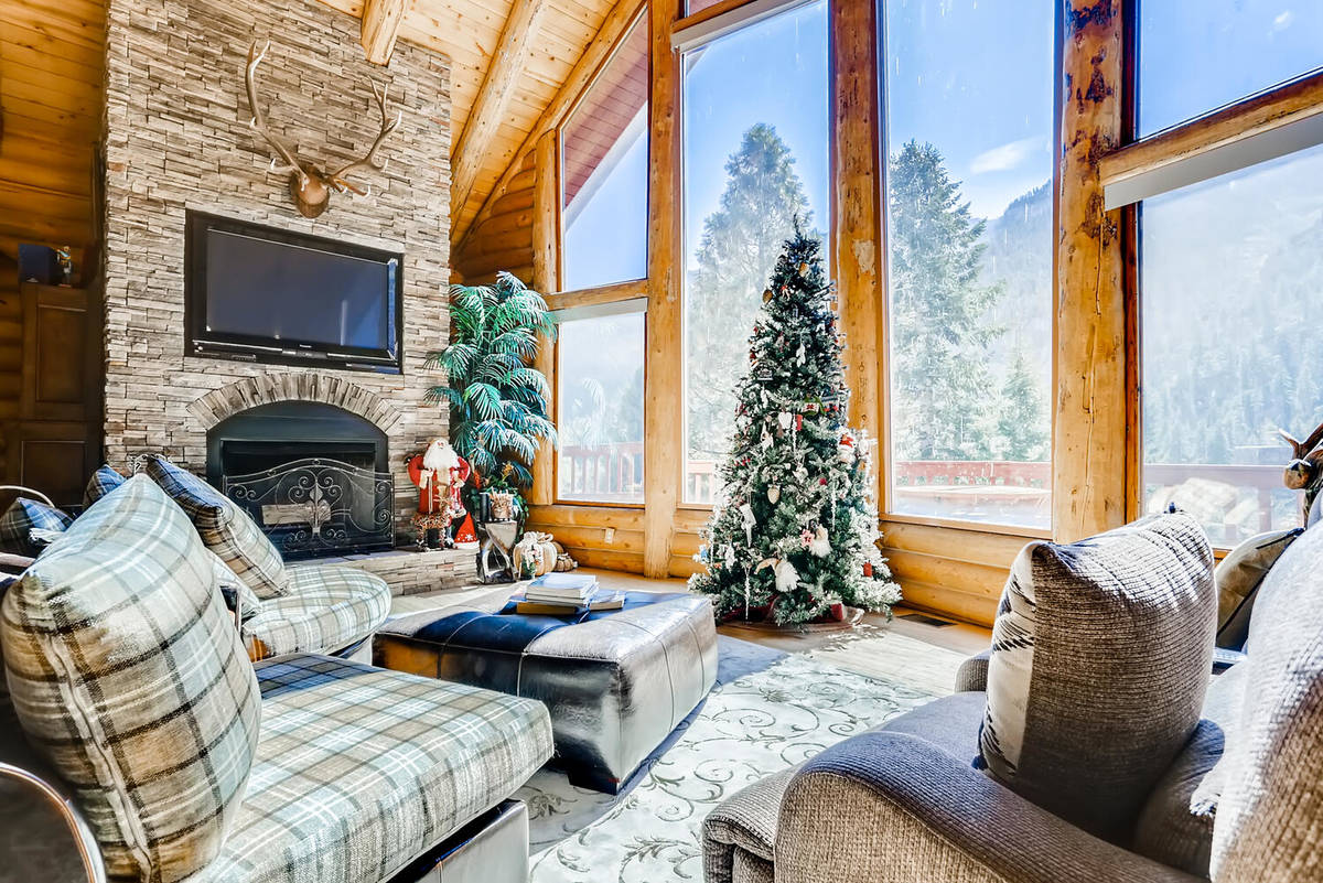 The home's living area has floor-to-ceiling windows that provide views of the Toiyabe National ...