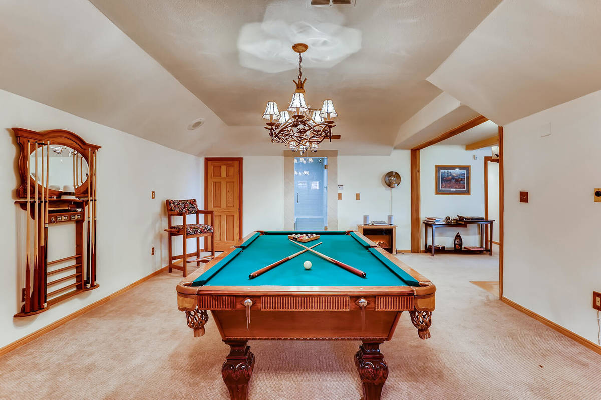 Mt. Charleston Realty The 3,728-square-foot, custom log cabin features a game room.