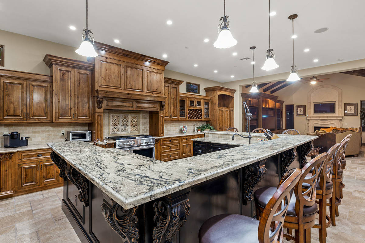 Downstairs features a massive chef's kitchen complete the latest appliances and plenty of cab ...