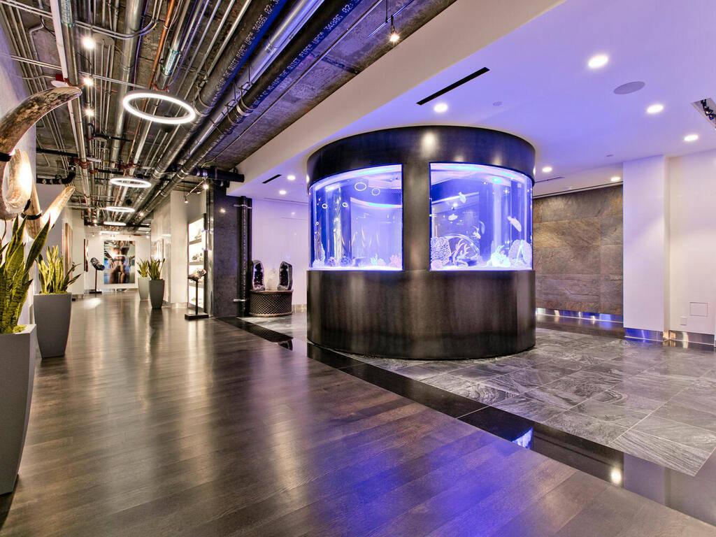 A custom circular fish tank. (Elite Realty)