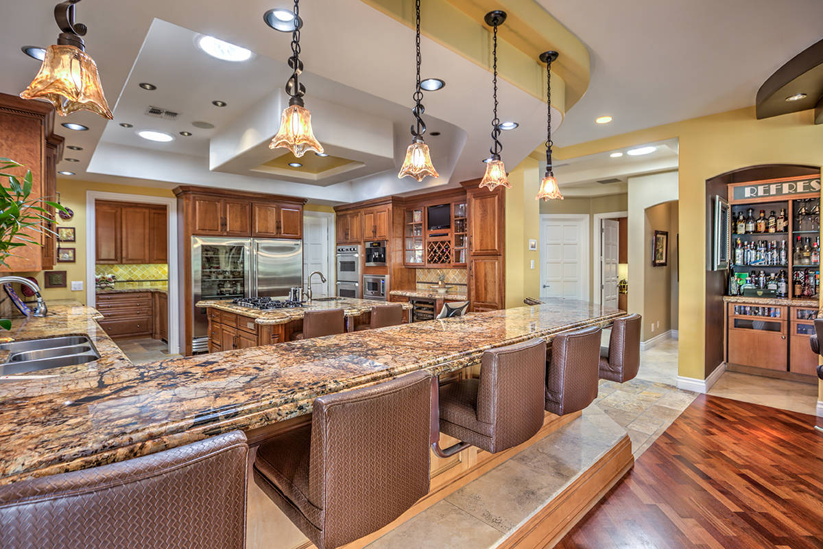 The kitchen has a large island with seating. (Mark Wiley Group)