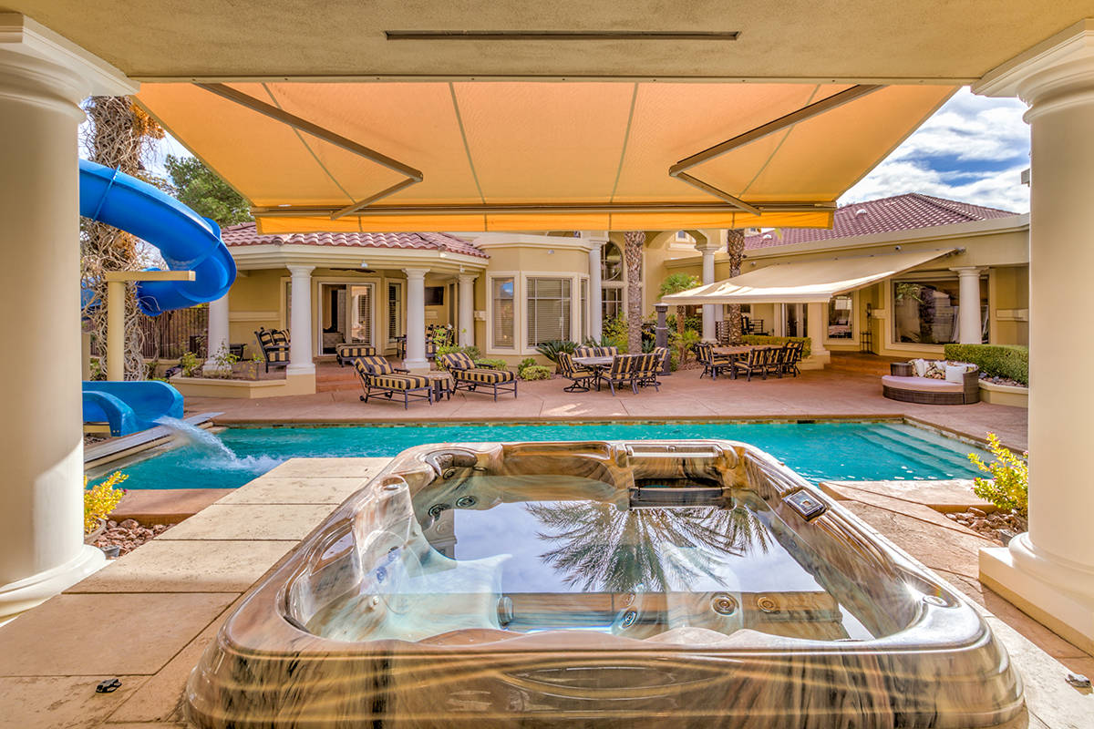 The home was built for entertainment and features a waterslide, fire pits spa and an out door k ...