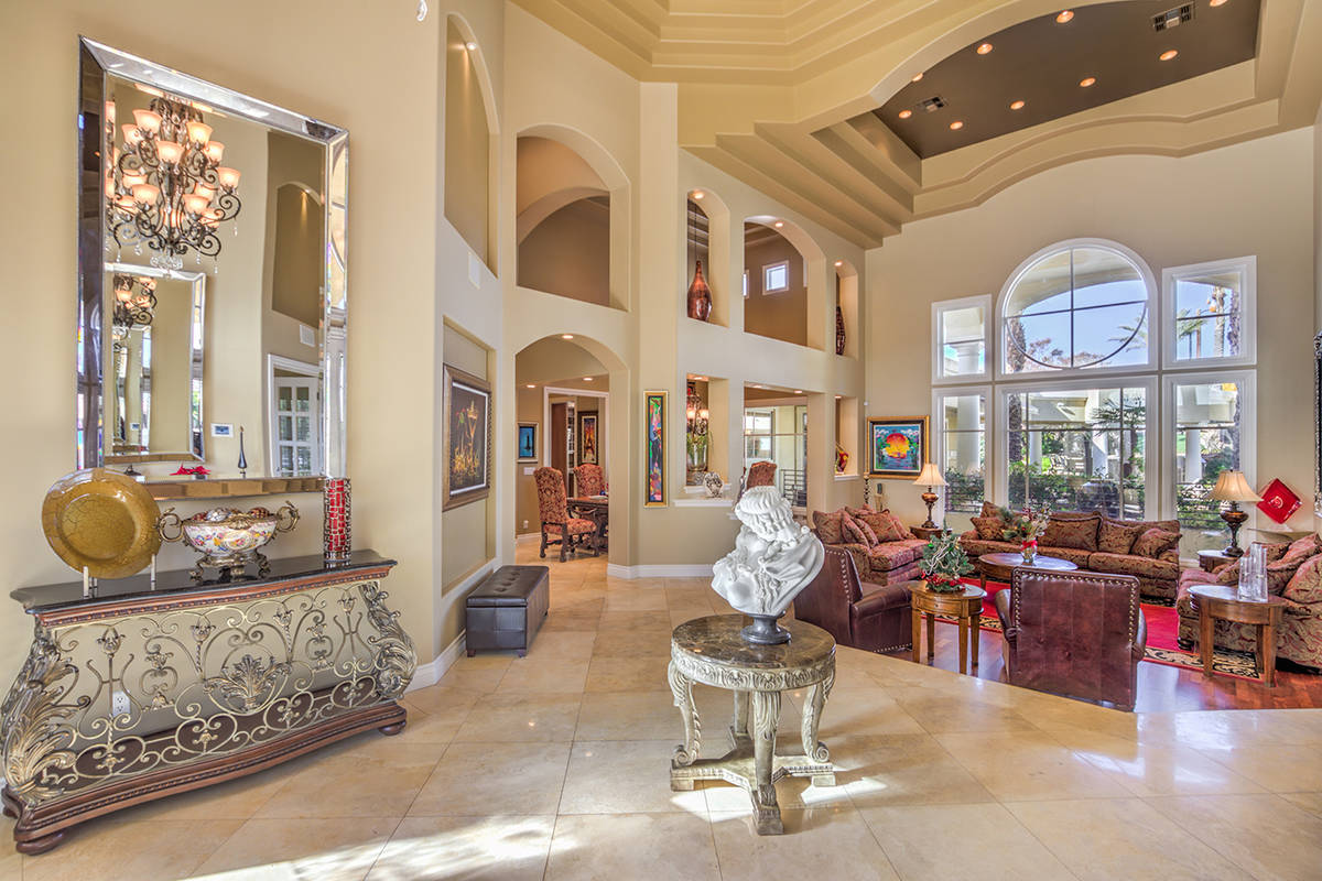 The six-bedroom, 10-bathroom, two-story Mediterranean-style home on the exterior measures 11,62 ...