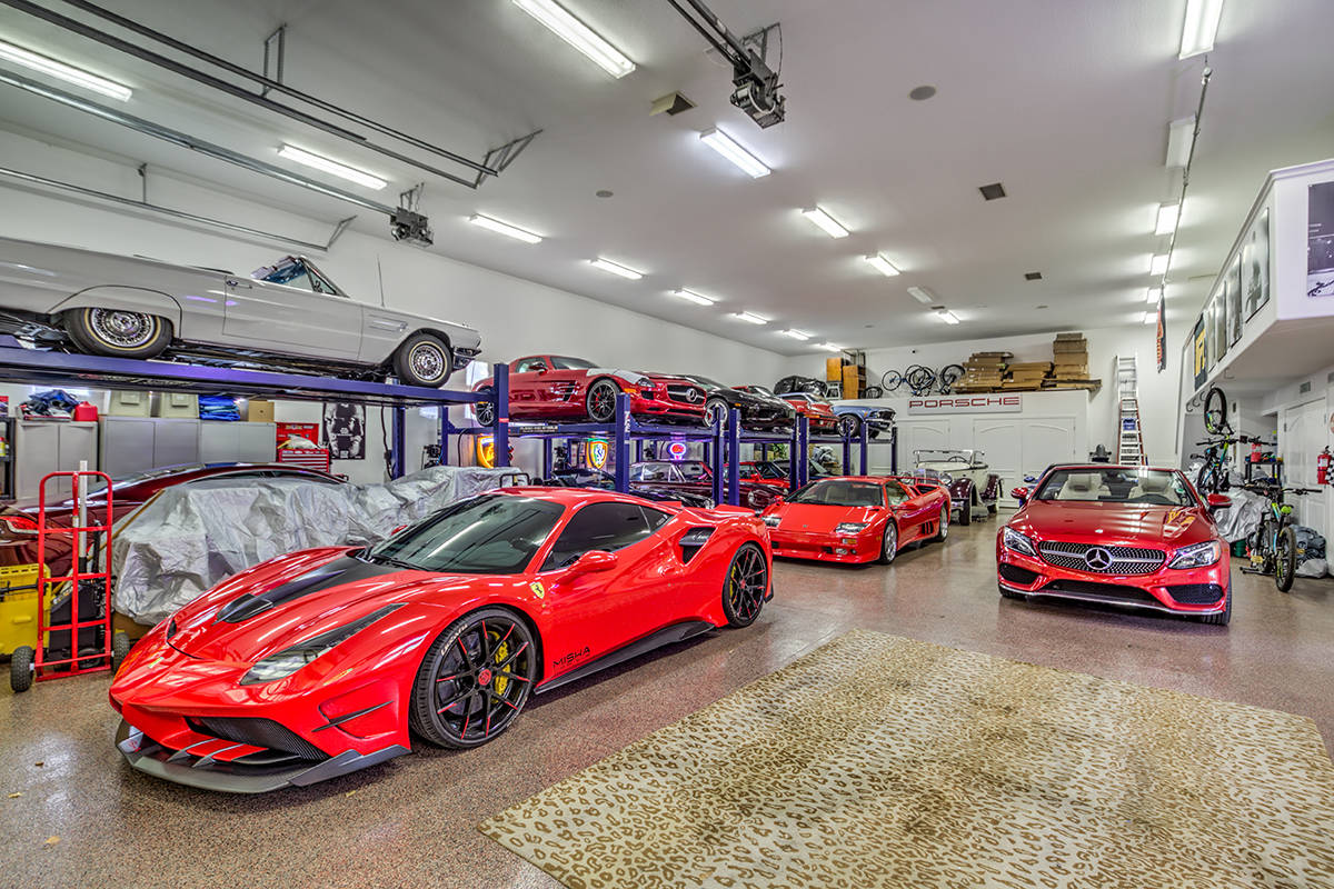 This car collector's dream at 7440 Oak Grove Ave. has enough garage space for 20 vehicles. It ...