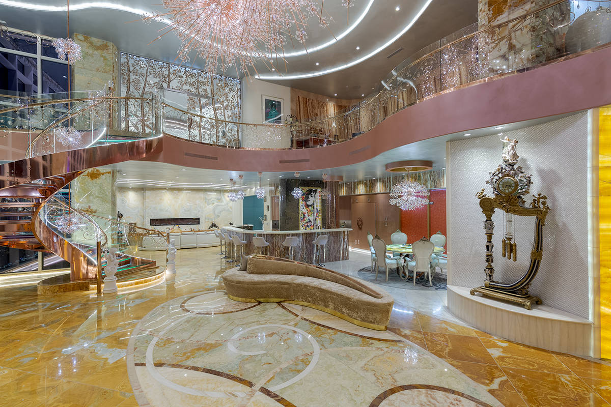 The three level Panorama Towers penthouse is laden with custom features and design. (Red Luxury ...
