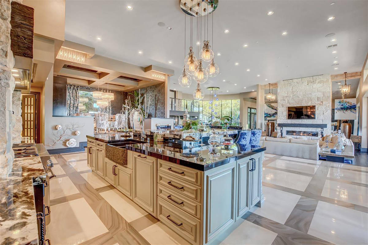 There's a Nick Alain custom chandelier in the kitchen along with a Thermador stove and two Th ...