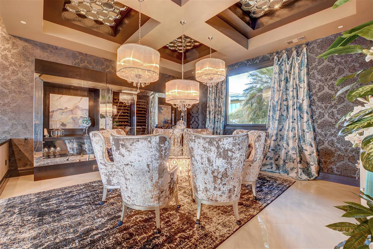 The dining room has custom furniture designed by Styles and Allegra box tray ceiling. (Keller ...