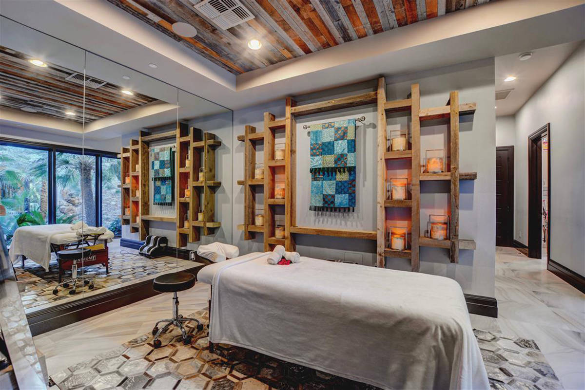 The mansion features a private wellness wing that includes a massage room, Finnleo steam room, ...