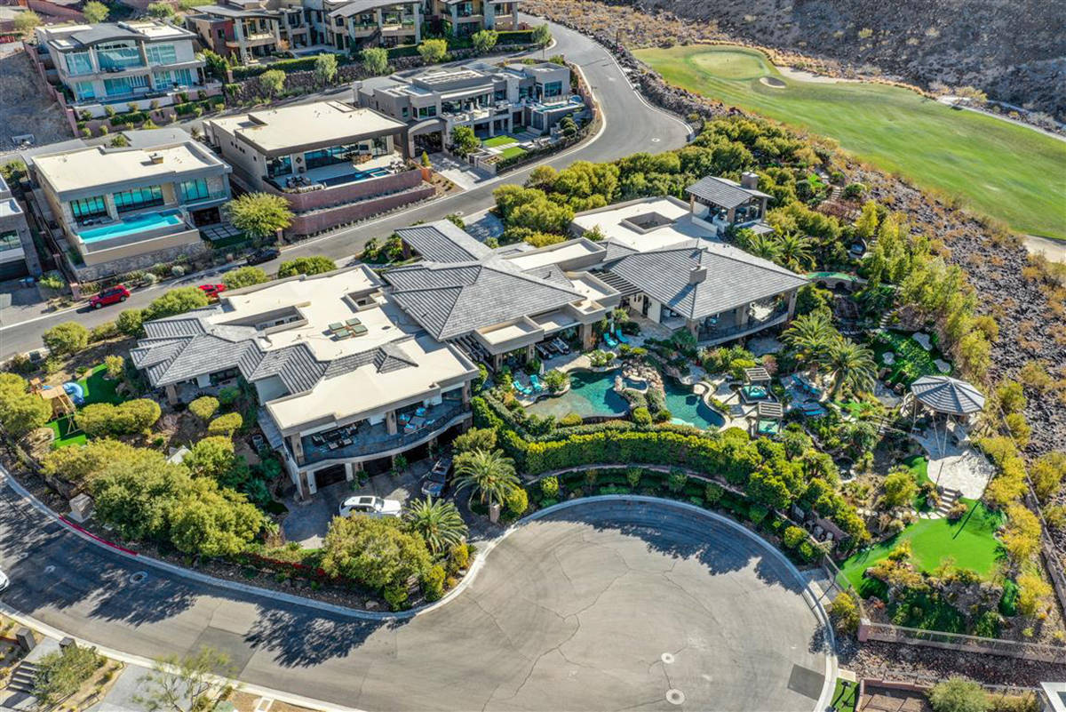 The 14,005-square-foot home sits on two acres near the DragonRidge Country Club in MacDonald Hi ...