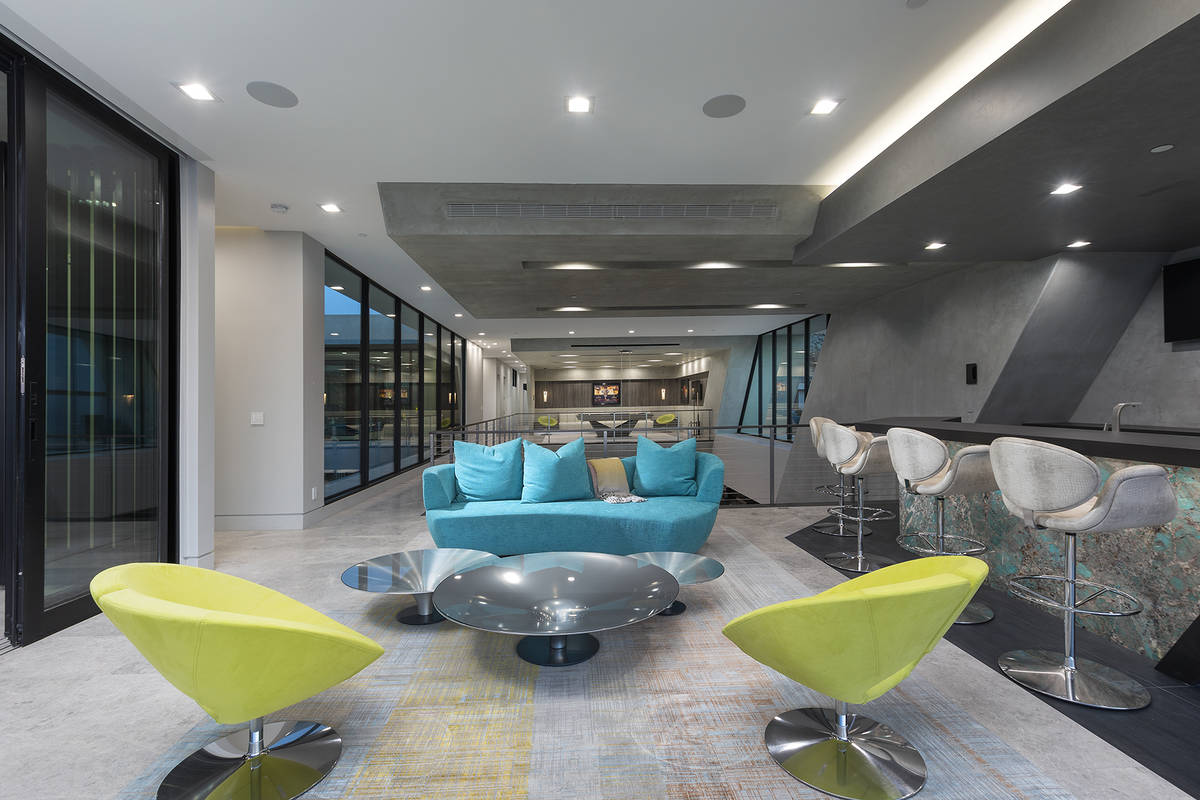 The upper bar area reflects the neon colors of the Strip. (Synergy Sotheby's International Re ...