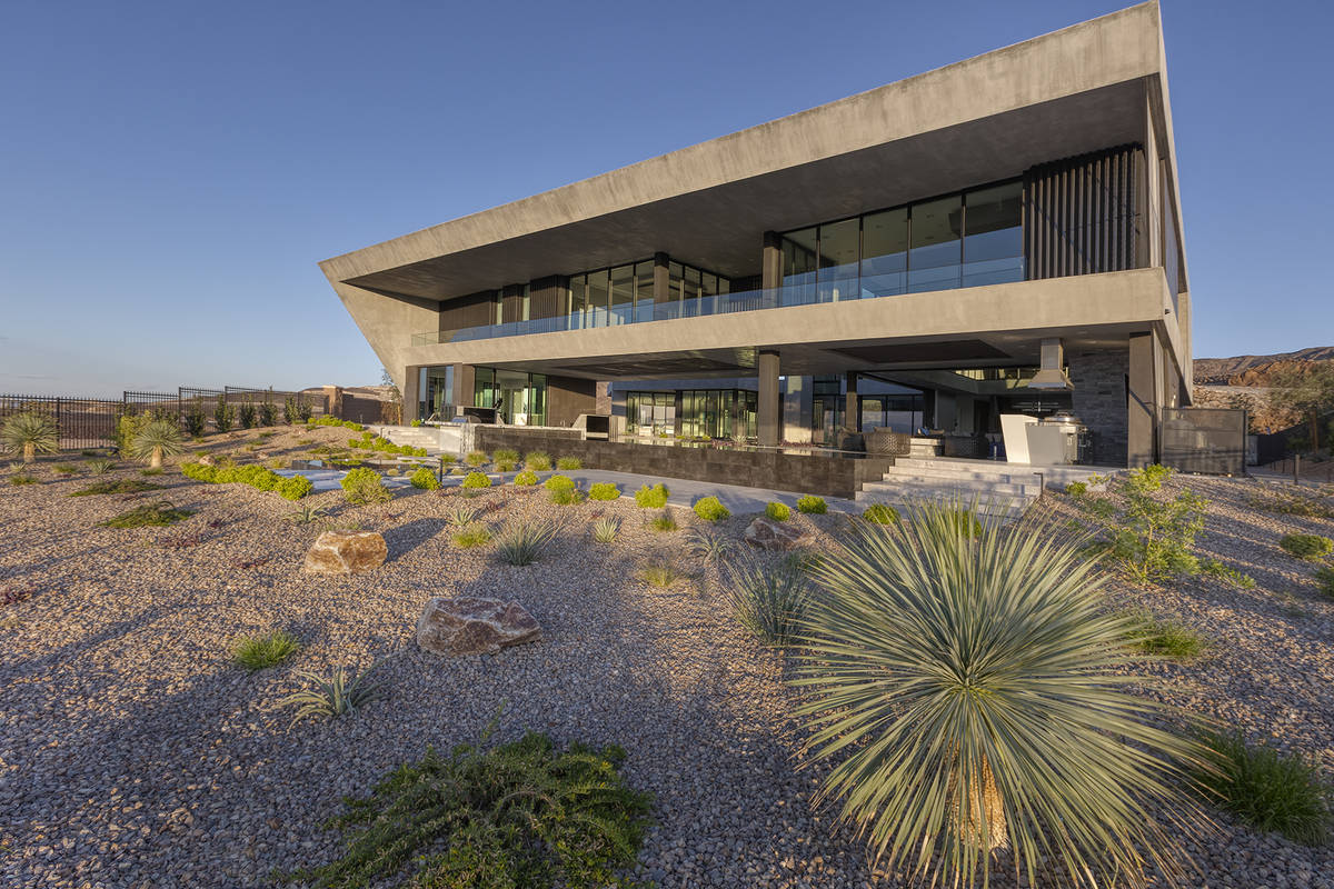 The home has desert landscaping. (Synergy Sotheby's International Realty)