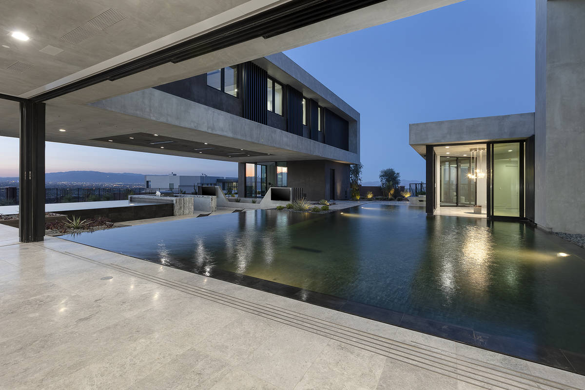 The pool connects elements of the home. (Synergy Sotheby's International Realty)
