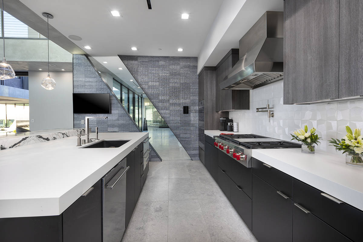 The highly functional hub showcases two-tone counters and cabinetry. (Synergy Sotheby's Inter ...