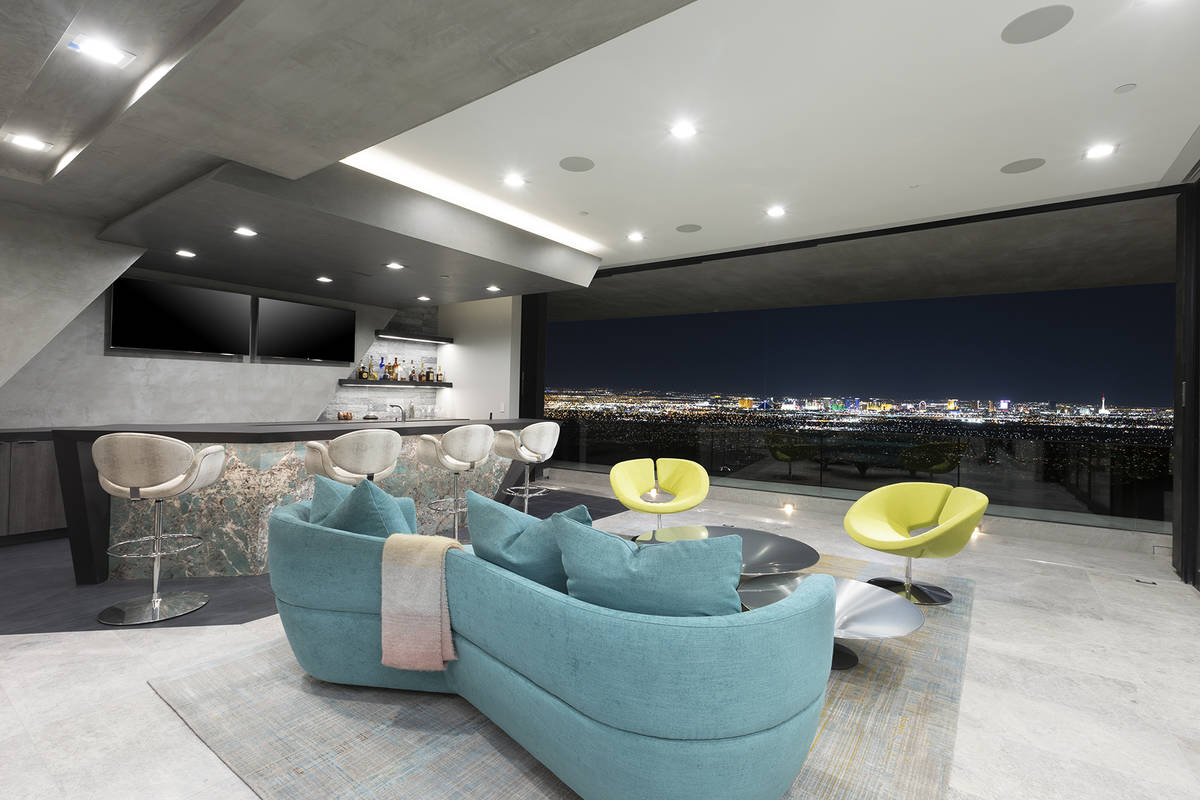 The color palette for the upper bar area reflects the neon colors of the Strip. Green couches a ...