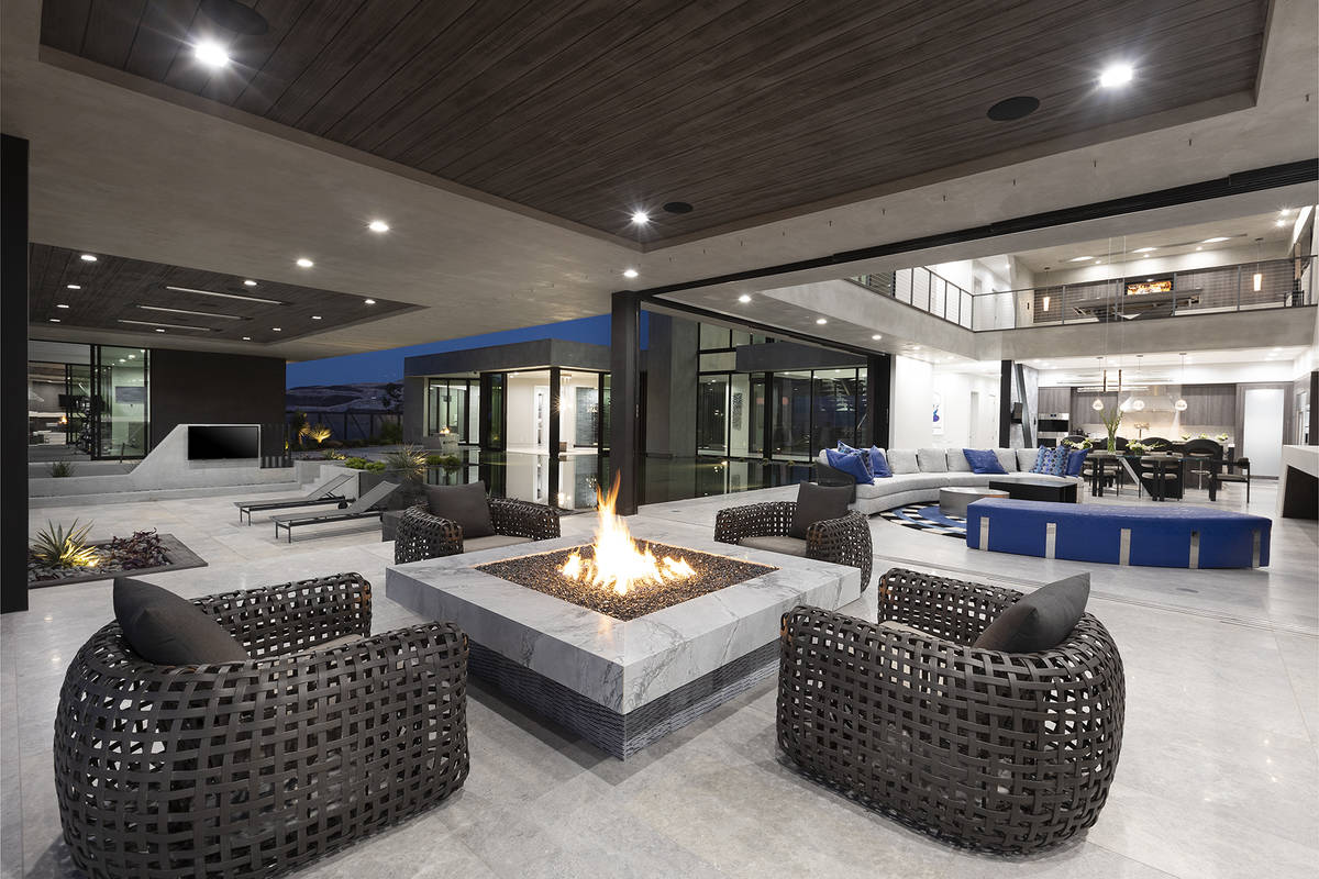 The patio off the living room has a fire pit. (Synergy Sotheby's International Realty)