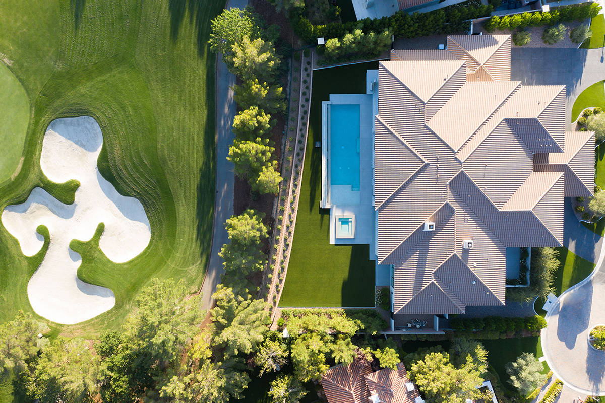 The new Southern Highlands Country Club luxury home was built by Unique Custom Homes. (Simply V ...