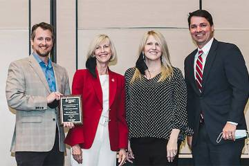 Communities in Schools of Southern Nevada Executive Director Cheri Ward, second from left, pres ...