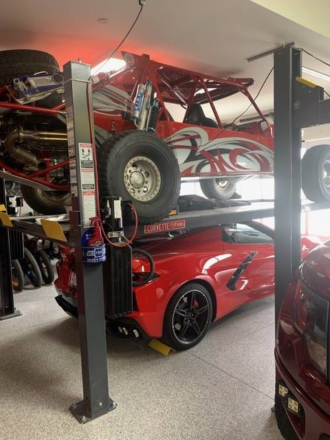 Mike Bilek Mike Bilek approaches the lack of garage space by storing his collection on hydrauli ...