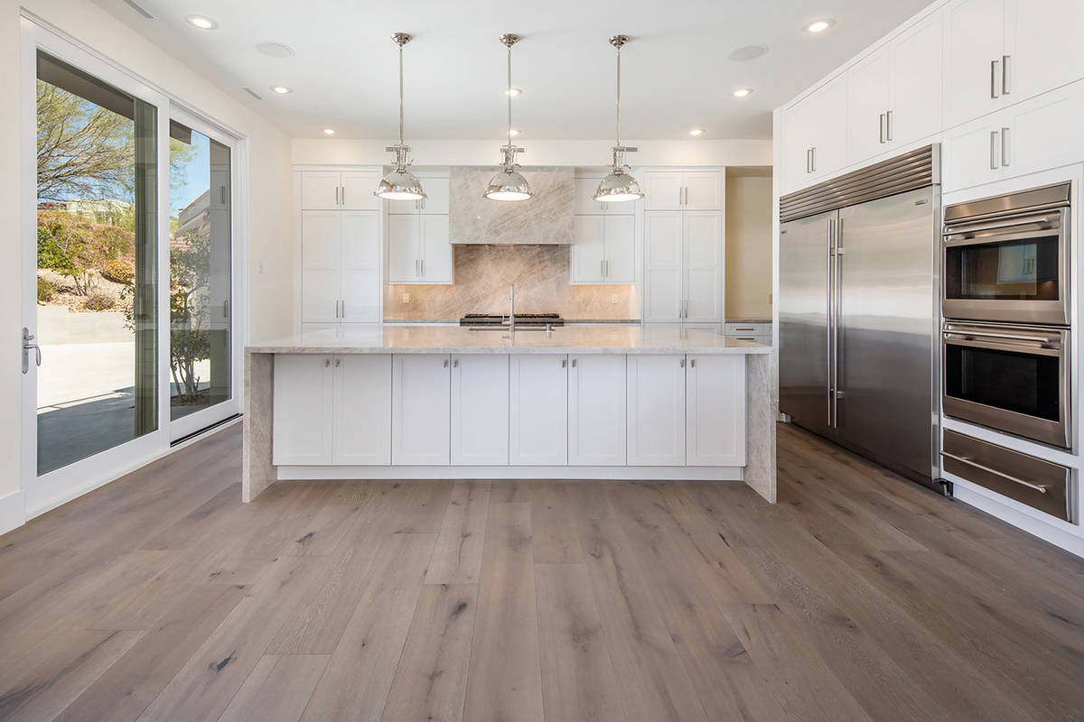 The kitchen features a large island with seating. (Ivan Sher Group)