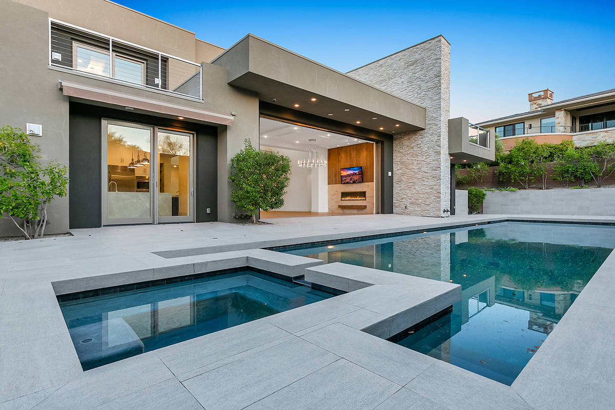The home has a pool and spa in the resort-style backyard. (Ivan Sher Group)