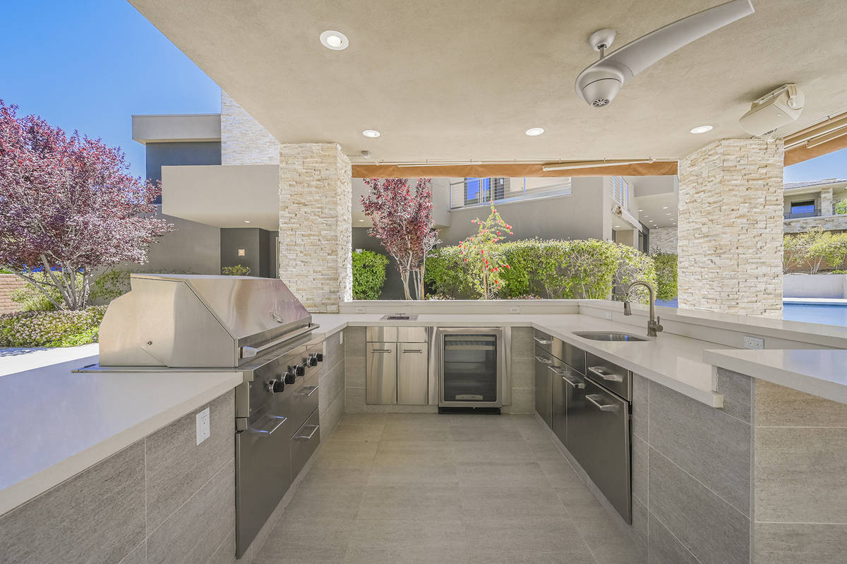 The home has a pool, spa in the backyard along with an outdoor kitchen in a pavilion, fire pit ...