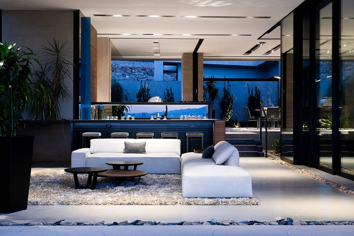 Vegas Modern 001 is a three-level home, which features two master suites with views of the Las ...
