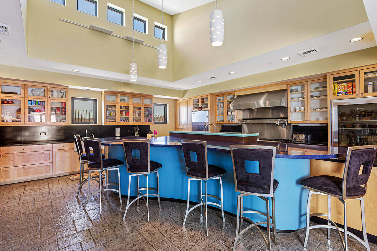The main level of former Lance Burton's home has a kitchen, pantry, breakfast nook with booth s ...