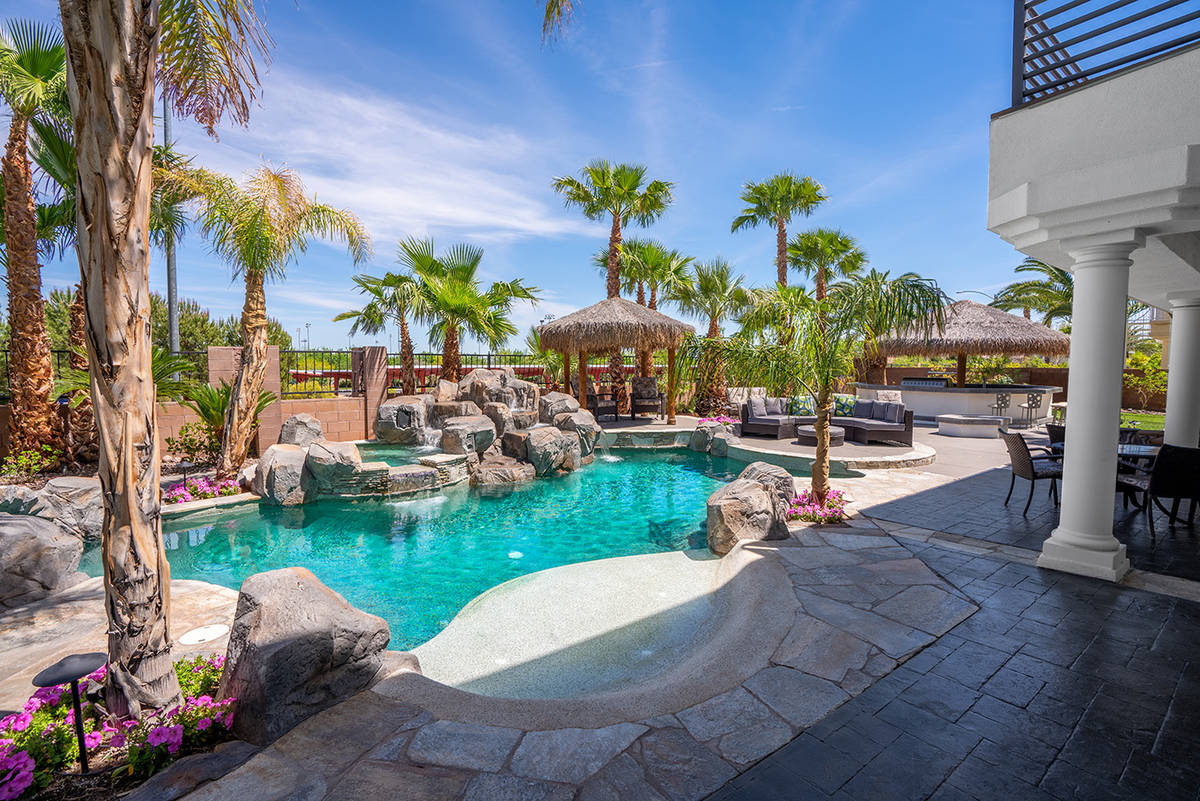 Michael Zelina Red Luxury The home showcases a The poolside full Viking kitchen. It is on the m ...