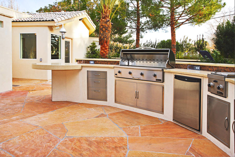 Outdoor kitchens are getting smaller but packed with more luxury and high-end features. (Ozzie ...