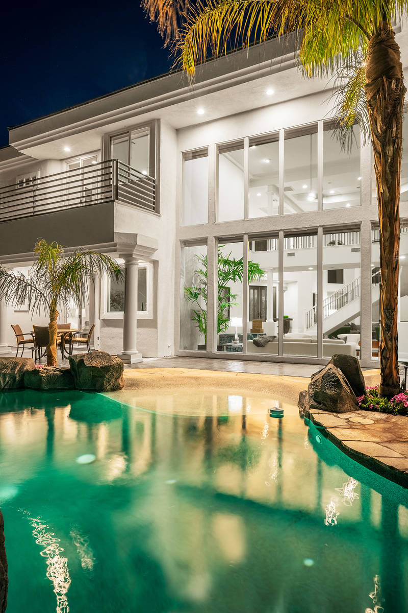 The owners of this luxury home at 2000 Bogart Court created a beach resort vacation feel for it ...
