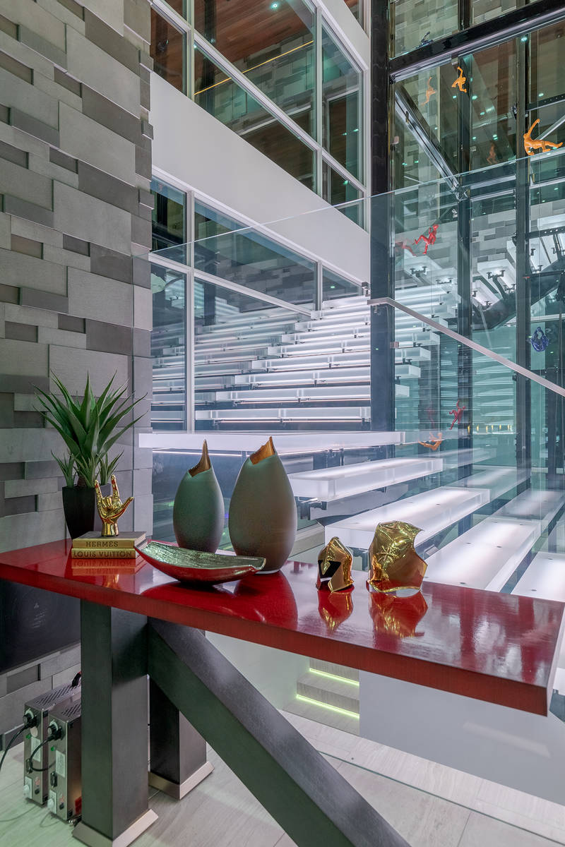 The home features glass walls. (The Ivan Sher Group)