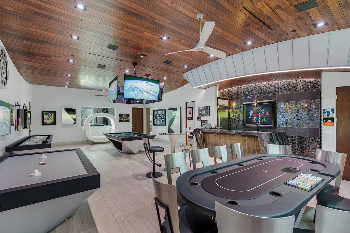 The mansion features a casino-inspired man cave with a wet bar, pool table, Texas Hold'em tab ...