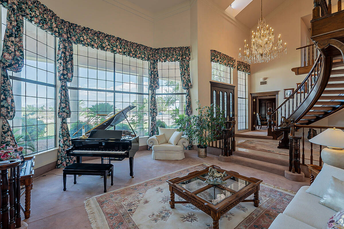 The home features floor-to-ceiling windows. (BHHS)