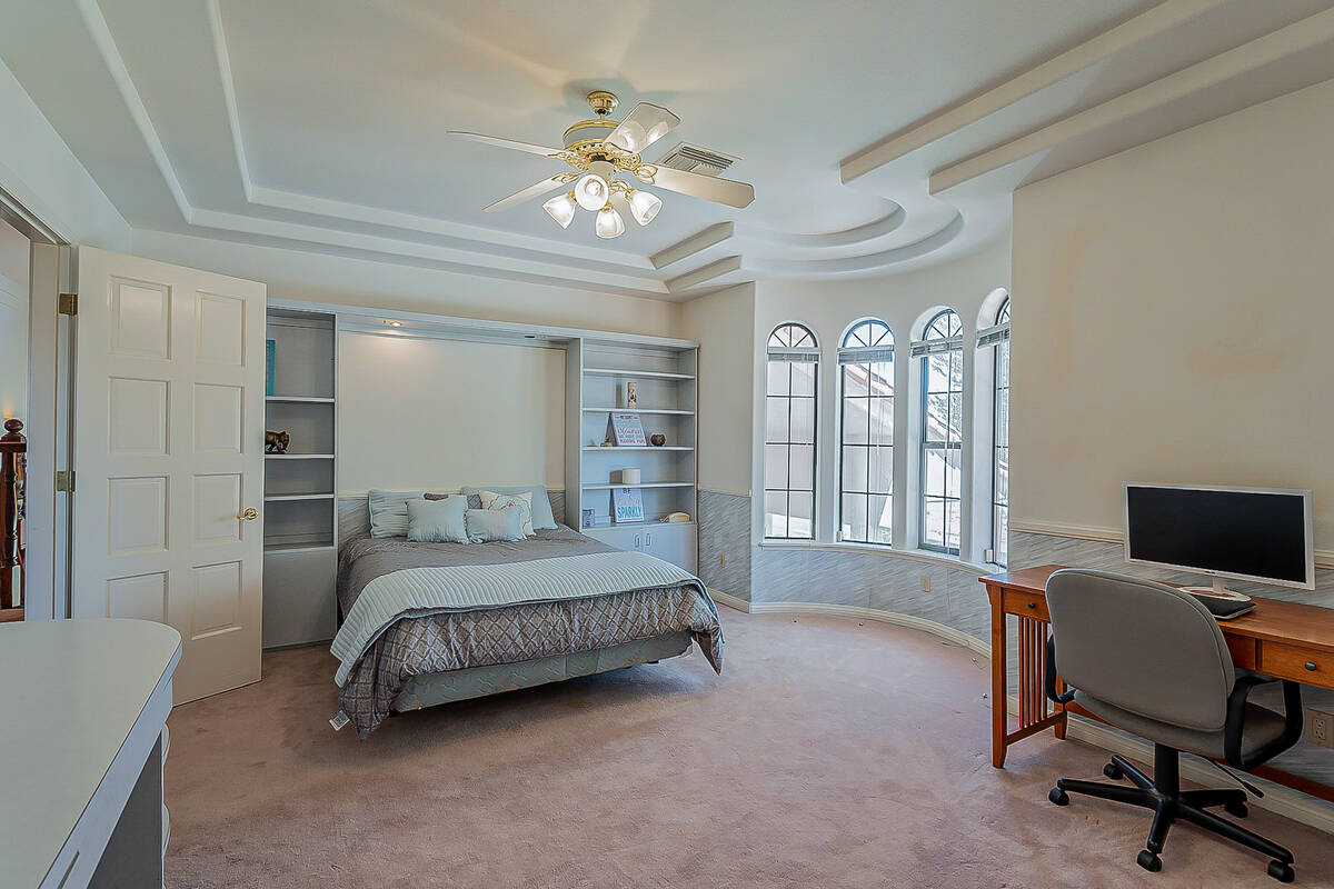 One of eight bedrooms. (BHHS)
