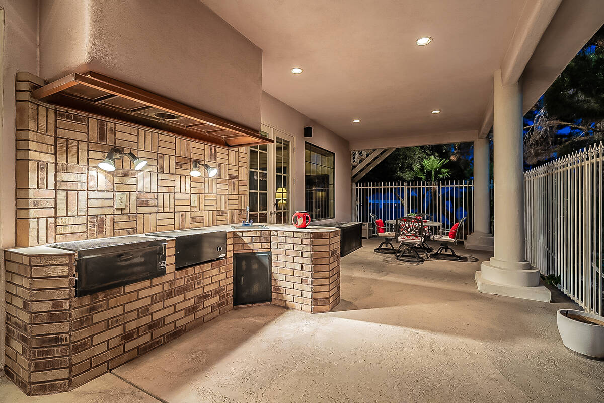 The home has an outdoor kitchen. (BHHS)