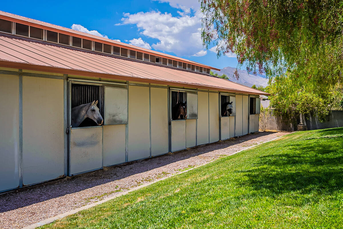 This 2-acre property has two barns. One that is air-conditioned and a professional dressage are ...