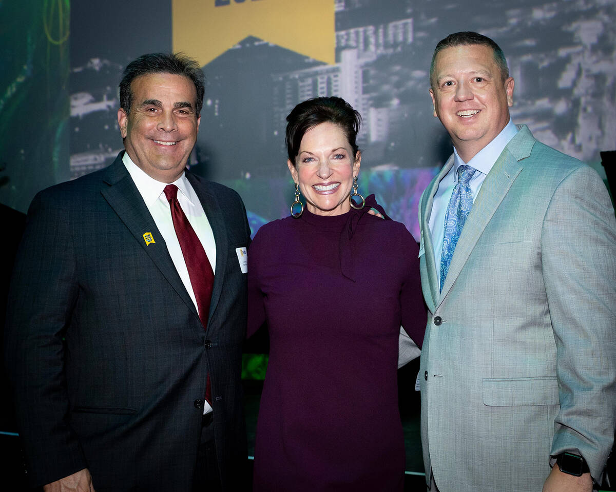 From left, CEO Bank of Nevada John Guedry, Vegas Chamber President and CEO Mary Beth Sewald and ...
