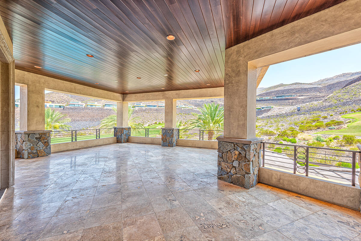 BHHS This MacDonald Highlands mansion features a wraparound covered balcony with views of the d ...