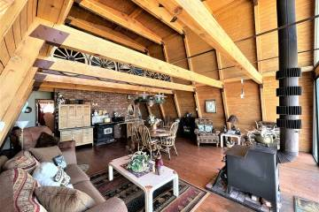 The 1,344-square-foot alpine-designed cabin is powered by a generator. A wood stove provides th ...